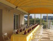 Motorized retractable roof by Almax